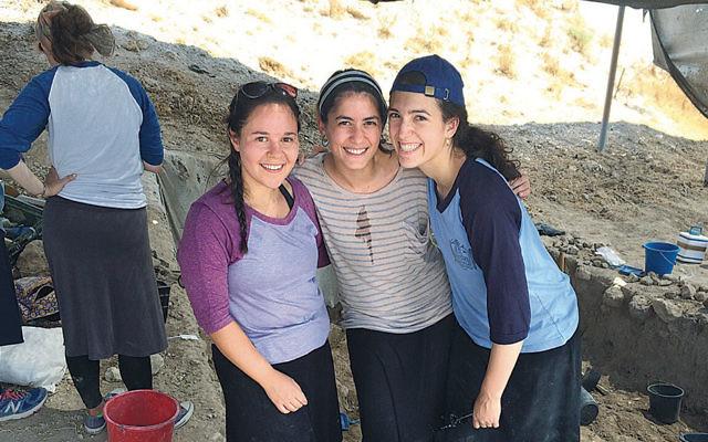 Teaneck residents Ariella Levie, left, and Rebecca van Bemmelen flank Elisheva Jacobov of Brooklyn at an archeological dig.