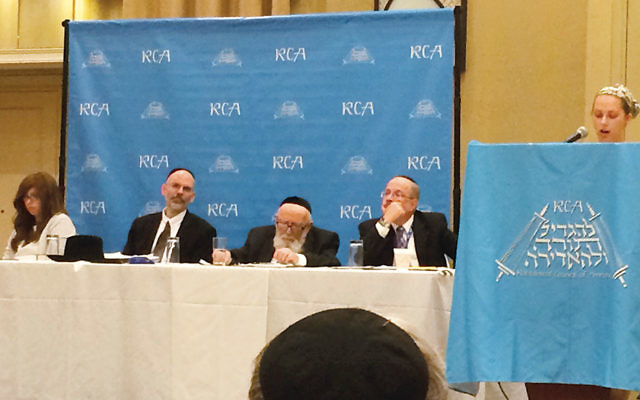 Bethany Mandel, a convert and a member of the GPS review committee, speaks. The panel onstage, from left: Evelyn Fruchter, like Ms. Mandel a convert and a GPS review committee member; Rabbi Yonah Reiss, Av Bet Din in Chicago, a dayan on the Bet Din of America and a committee member; Rabbi Gedaliah Schwartz, Av Bet Din of the Bet Din of America, Rosh Bet Din on the ChicagoBet Din, and one of the RCA's major halachic arbiters, and Rabbi Shmuel Goldin, on the panel. Courtesy of RCA