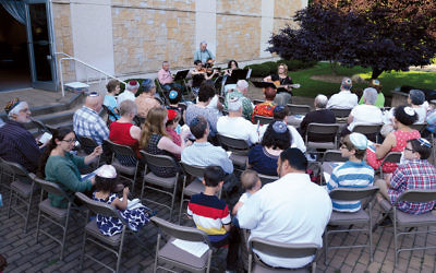 Recently, members of both shuls gathered for a pre-Shabbat service at Temple Israel.