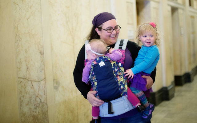 Tovah Gidseg in the hall of the Bergen County Courthouse after her family adopted their two youngest children. (Maegan Dougherty Photography)