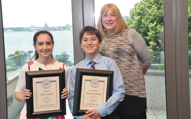 Eliana Suldan and Benjamin Edelman display their awards as they stand with Yavneh's Barbara Rubin. The Kaplun Foundation