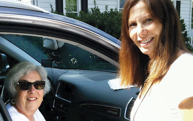 Member rider Joanne Divney, right, and member driver Elizabeth Brand. Ms. Divney is a frequent rider with ITNNorthJersey while she recovers from knee surgery.
