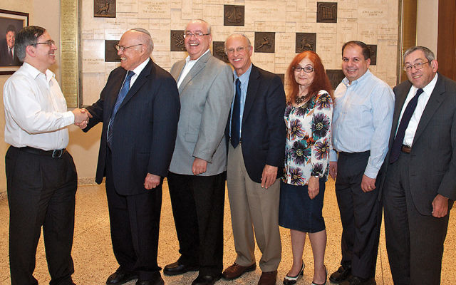 Nominating committee chair Sanford Hausler, left, with shul president Isaac Student; first vice president Sigismund Laster; second vice president Dr. Steven Myers; third vice president Elizabeth Sher; treasurer Allen Ezrapour, and secretary Daniel Chazin. (Michael Laves)
