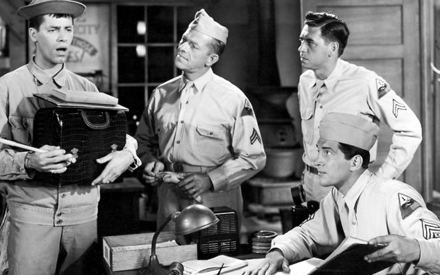 """Jerry Lewis, left, in """"At War with the Army."""" Dean Martin, seated, watches him. Photos courtesy www.doctormacro.com"""