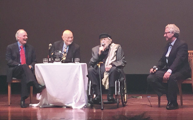 In May, Mr. Bikel, in wheelchair, spoke at Kulturfest NYC. With him, from left, are actor Alan Alda, film director John Lollos, and Jewish Standard film critic Eric Goldman.
