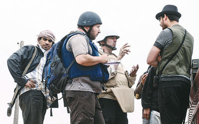 Steven Sotloff, center, wearing a black helmet, talks to Libyan rebels on the Al Dafniya front line, about 15 miles from Misrata, Libya, on June 2, 2011.  Etienne de Malglaive via Getty Images