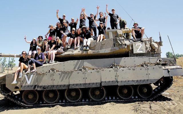 FIDF YL Mission participants, including Jaime Chavkin of Little Falls, atop an IDF Armored Corps Merkava IV main battle tank. (Oren Cohen)