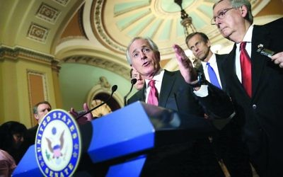 """Senator Bob Corker of Tennessee, the Foreign Relations Committee chairman, at a Washington news conference in March 2015. Corker wondered whether implementing the Iran agreement was worth dismantling a """"painstakingly constructed sanctions regime."""" (Win McNamee/Getty Images)"""
