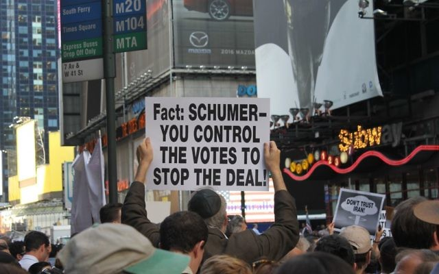 "A protester's sign urging U.S. Sen. Chuck Schumer to vote against the Iran deal at the ""Stop Iran Now"" rally in Times Square, July 22, 2015. (Gabe Friedman)"