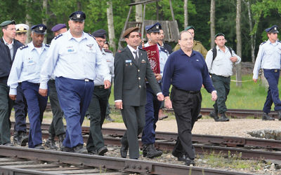 Mr. Foxman walks on railroad tracks to Auschwitz on the March of the Living.