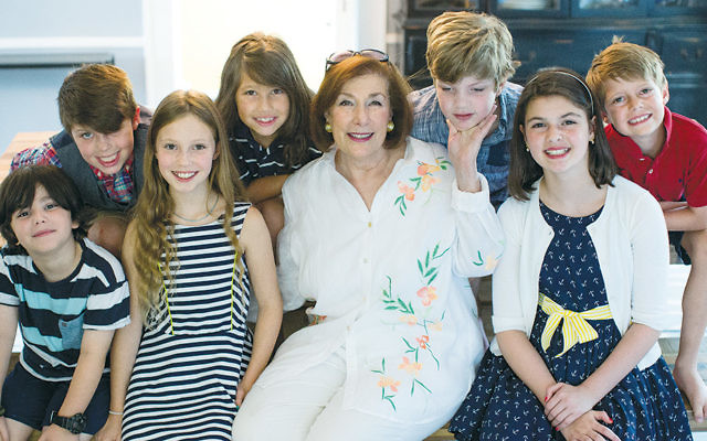 Dianne Nashel is surrounded by her five grandsons and two granddaughters. Raina is at the right. ( M. Nashel Photography)