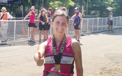 Sunni Herman beams after Sunday's West Point triathlon.