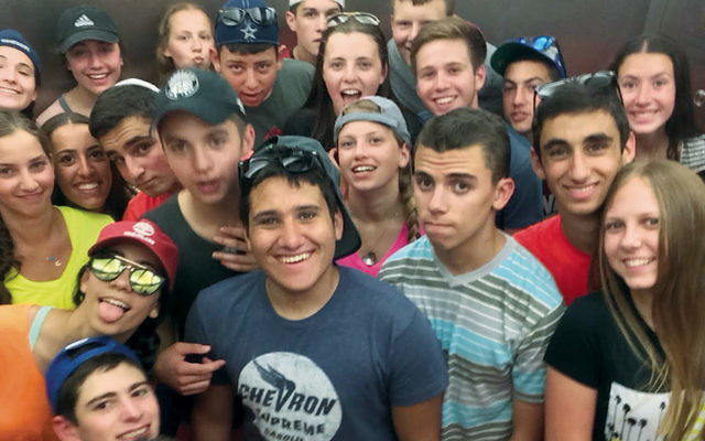 Noah Thurm, center, and other Camp Koby counselors from the United States mug for the camera. (Dovi Chrysler)