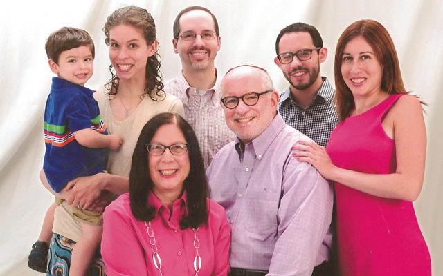 Dr. Steven Huberman and his wife, Frieda, surrounded by their family. From left, grandson Eitan, 3; his parents, Becky and Daniel Huberman; son Jonathan, and daughter Shira.