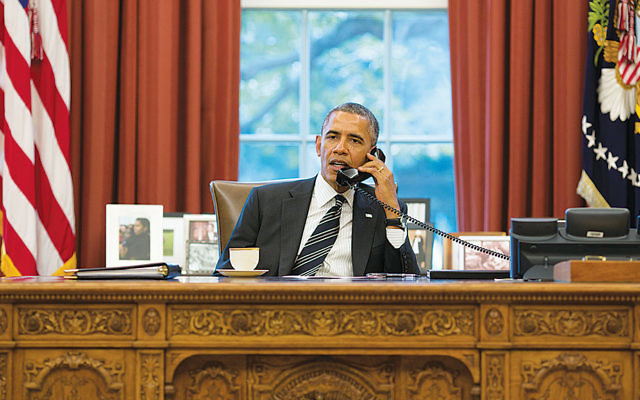 President Barack Obama talks with President Hassan Rouhani of Iran during a phone call in the Oval Office in September 2013. (Pete Souza/ Getty Images)