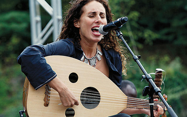 Basya Schechter, the cantor at the Fire Island Synagogue, performs in Central Park in 2013. (Getty Images)