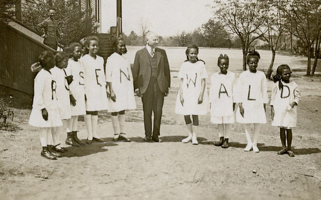 ulius Rosenwald is surrounded by students from a Rosenwald school. (Fisk University)