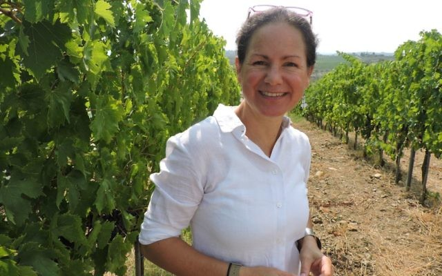 Maria Pellegrini, who owns the winery with her husband, grew up in a winemaking family in southern Italy. But because she isn't Jewish, she can't take part in the winemaking in her own winery. (Ben Sales)