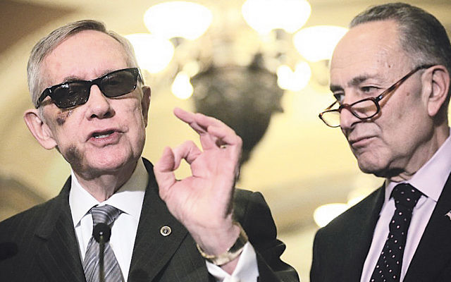 Senator Harry Reid, left, the Senate minority leader, and his likely successor, Senator Charles Schumer, at a news briefing in Washington, D.C., in February. Reid is supporting the Iran deal and Schumer said he will vote against it. (Alex Wong/Getty Images)
