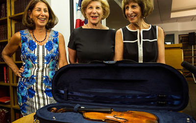 NEW YORK, NY - AUGUST 06:  (L-R) Amy Totenberg, Nina Totenberg and Jill Totenberg view their father's Stadivarius violin, which was stolen after a concert 35 years ago, at an FBI press conference announcing the recovery of the violin on August 6, 2015 in New York City. Roman Totenberg, their father, was a famed violinist who died three years ago.  (Photo by Andrew Burton/Getty Images)