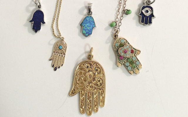 The hamsa, representing the hand of God, is said to ward off harm. These all are from Rahel Musleah's own collection.