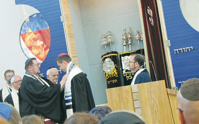 Rabbi Dr. Walter Homolka, rector of Geiger College, left, ordains Rabbi Alexander Grodensky as Rabbi David J. Fine, right, looks on. Rabbi Grodensky now serves the community of Esch-zur-Alzette in Luxembourg. (Alla Fine)