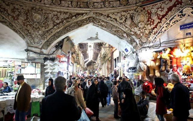 Iranians walking through Tehran's old main bazaar, March 18, 2014. (Ebrahim Noroozi/AP Images)