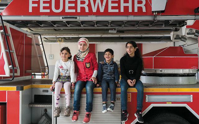 Refugee children visit a fire station in Berlin. (Judith Kessler)