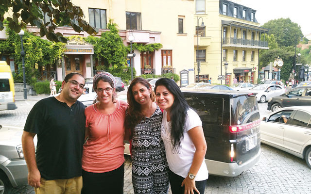 From left, Israeli tourists Liad and Einat Shemesh, Adi Amram and Ortal Panehla outside the Great Synagogue of Tbilisi in August. (Cnaan Liphshiz)