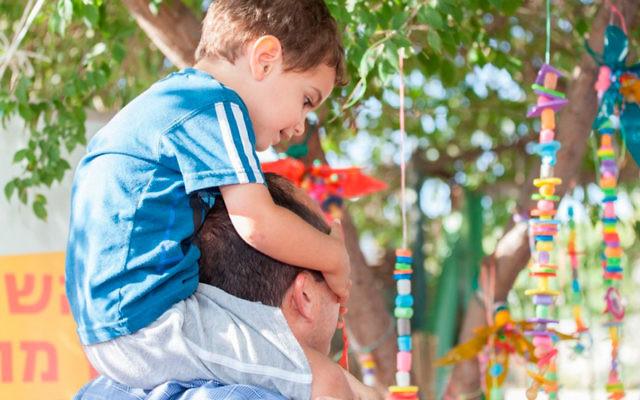 Sixty preschoolers in Jerusalem's Gonenim neighborhood hung their pacifiers on the tree. (Photo by Hadar Levi)