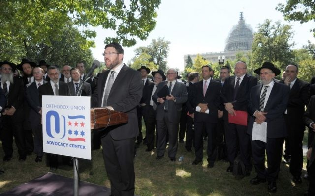 Orthodox Rabbi Marc Penner speaking at the Tea Party rally against the Iran deal on Capitol Hill in Washington, D.C. on Sept. 9, 2015. (Ron Kampeas)