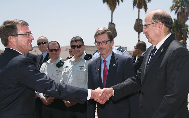 U.S. Defense Secretary Ash Carter, left, shaking hands with his Israeli counterpart, Moshe Yaalon, before boarding a military aircraft at Ben Gurion Airport near Tel Aviv on July 21. (Carolyn Kaster/Pool/AP Images)