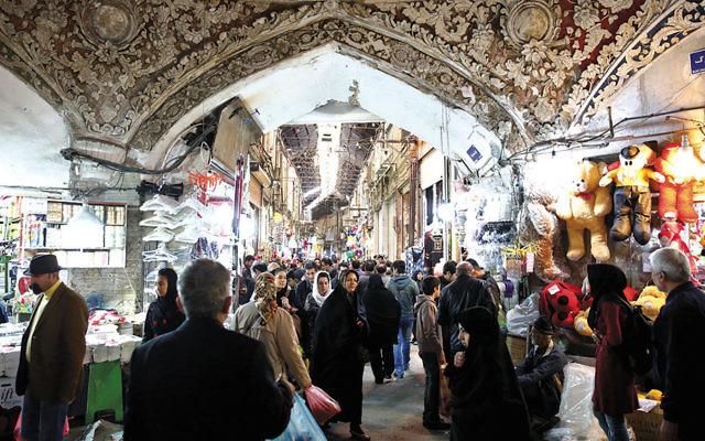 Iranians walk through Tehran's old main bazaar in March. (Ebrahim Noroozi/AP Images)