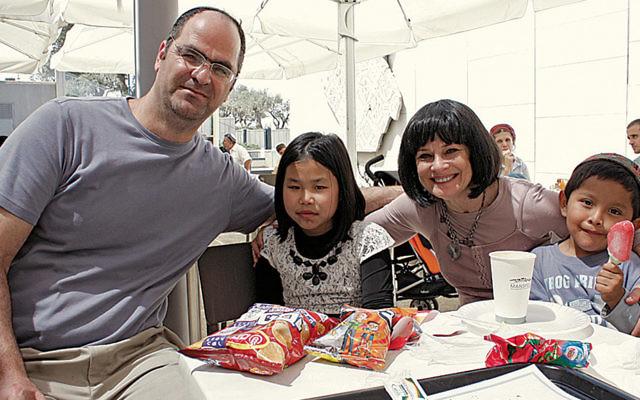 Yacov, Zehava, Shashi, and Zaki Ishai share snacks in Israel. (Shashi Ishai)