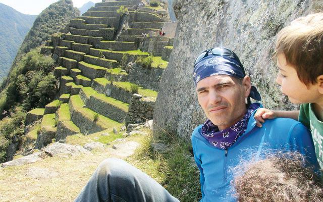 Joel Chasinoff and his son explore the ruins of Machu Picchu in Peru.