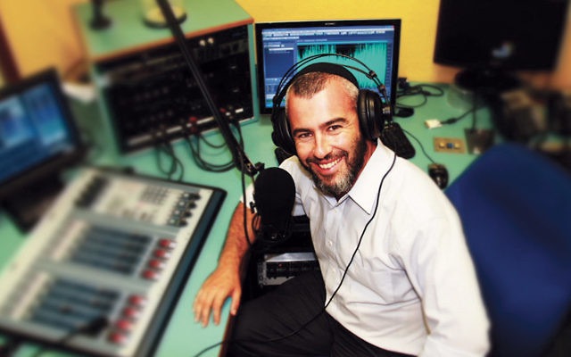 Rabbi Yishai Fleisher prepares for a radio podcast. He is in demand as an analyst on israel for many media outlets.