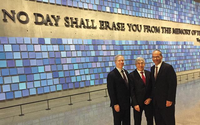 From left, the AJC's David Inlander, Stanley Bergman, and Rabbi Noam Marans stand in front of the 9/11 Museum's memorial wall.