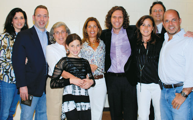 The Taub family, along with a performer, is together at one of the concerts. From left, Benay, Steven, Mickey, and Sarah, Judy Gold, klezmer musician Mitch Smolkin of Toronto, Shelley Taub, Ron Gold, and Ira Taub.