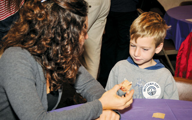 Children and adults take part in Mitzvah Day holiday projects. This one from last year was at the YJCC. (Herb Benkel)