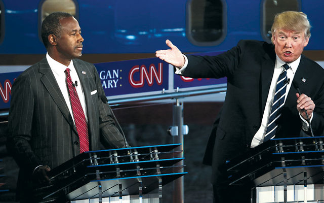 Ben Carson and Donald Trump are at the second Republican presidential debate at the Reagan Library in Simi Valley, California on September 16.  (Justin Sullivan/Getty Images)