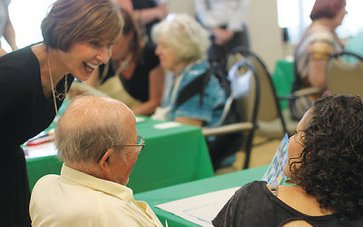 Jewish Home Family CEO Carol Silver Elliott with residents and volunteers taking part in the Opening Minds Through Art program, which aims to give autonomy and decision-making through artistic expression to residents with dementia.