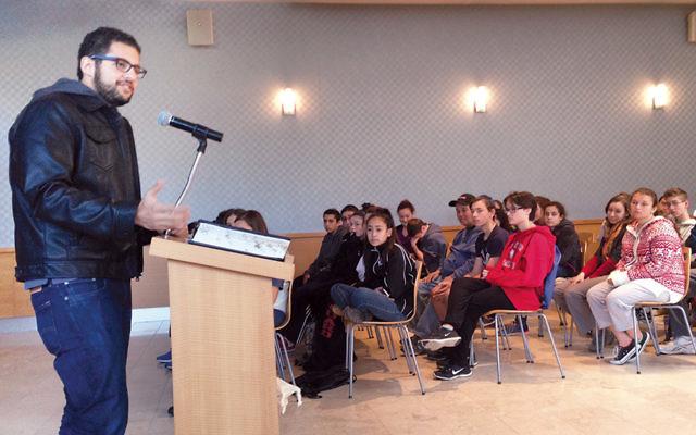 Hussein Aboubakr addresses BCHSJS students and parents.