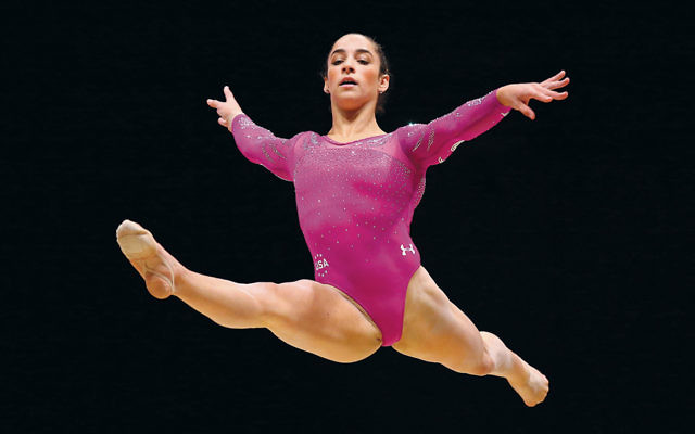 Aly Raisman competes in the floor exercise at the 2015 World Artistic Gymnastics Championships in Glasgow, Scotland. (Alex Livesey/Getty Images)