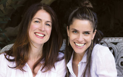 Amanda Peet, right, and her friend Andrea Troyer co-wrote a book about Jewish children dealing with the inescapability of Christmas.