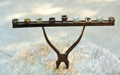 Pliers and some nuts find new life as a menorah.