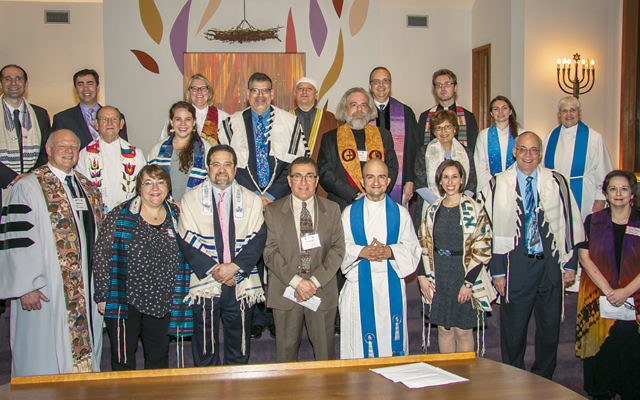 The clergy at Temple Beth Or last Sunday night represented 18 local congregations. (Antony Morales)