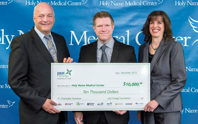 Miriam Stiefel, the director of Just Energy's national affinity program, and Shon Prejean, center, Just Energy's national affinity sales director, present the $10,000 donation to Michael Maron, president and CEO of Holy Name Medical Center.