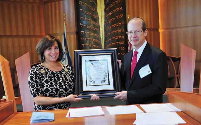 Stephanie Z. Bonder, president of Hadassah of Northern New Jersey, presents Chief Justice Stuart Rabner of the New Jersey Supreme Court with the Myrtle Wreath award. (Courtesy Hadassah)