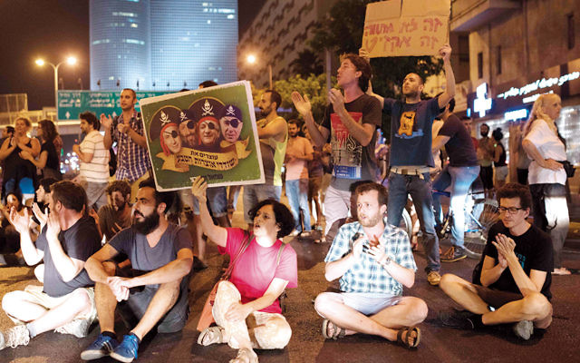 In June, demonstrators in Tel Aviv protested the Israeli government's support of a deal that would give two energy companies control over the development of most of Israel's offshore gas deposits. (Ben Kelmer/Flash90)