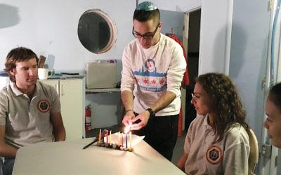Barak Stoltz lights Chanukah candles in the Mars Desert Research Station. (Courtesy Barak Stoltz)